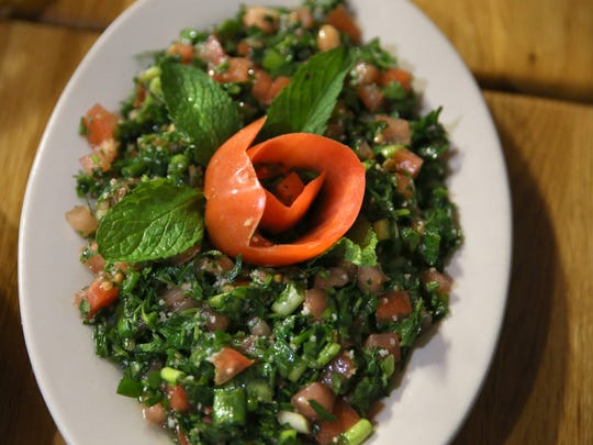 Taboule salad is served up with appetizers at Cedar Restaurant at 746 Monroe Ave.