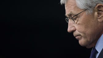 In this March 31, 2014, file photo, Secretary of Defense Chuck Hagel speaks during a press conference at the Pentagon.