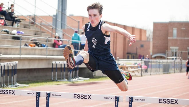 Will Lynch of Burlington competes in the 300 hurdles at the Essex vacational meet Friday.