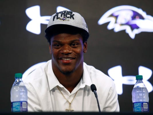 45c58dfd3 Lamar Jackson signs four-year contract with the Baltimore Ravens