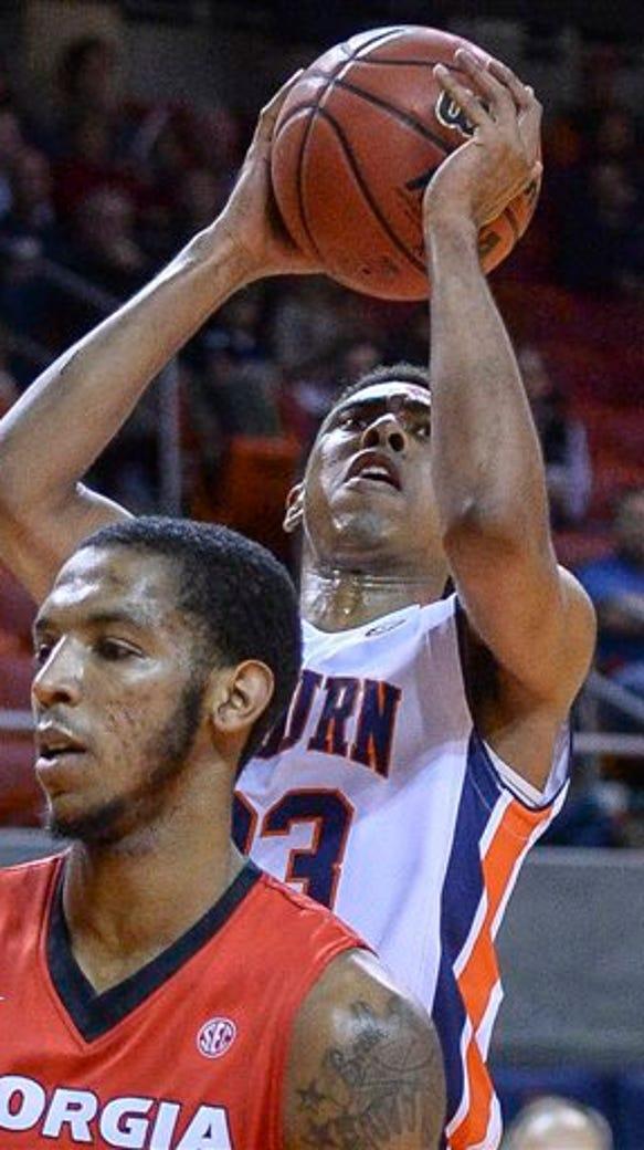 Auburn guard TJ Lang (23) shoots against Georgia during