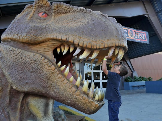 Jeremy Ramirez, 6, gets an up-close look at a replica dinosaur head during last year's Jurassic Quest at the Ventura County Fairgrounds.