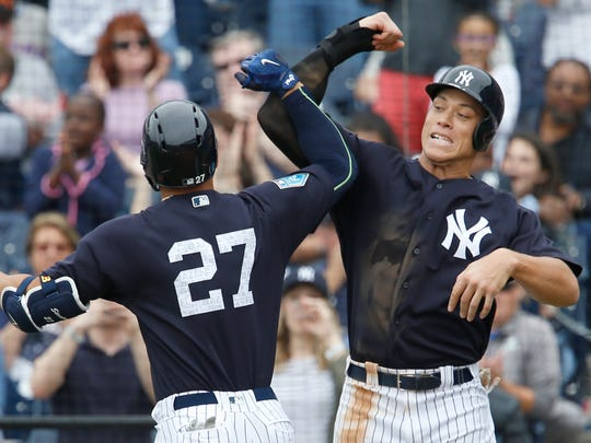 New York Yankees right fielder Giancarlo Stanton (27) and Aaron Judge (right) congratulate each other following Stanton's 2 run home run during the fifth inning against the New York Mets at George M. Steinbrenner Field.