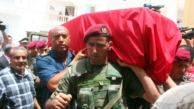 Family, friends and officers carry the Tunisian flag-draped coffin during the funeral Friday of Col. Fathi Bayoudh, one of the victims killed Tuesday at the blasts in Istanbul's Ataturk airport.