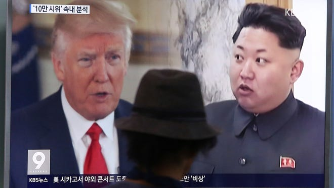 """FILE - In this Aug. 10, 2017, file photo, a man watches a television screen showing U.S. President Donald Trump and North Korean leader Kim Jong Un during a news program at the Seoul Train Station in Seoul, South Korea. Trump's recent invocation of """"fire and fury"""" in response to North Korea's nuclear weapons program had a familiar ring to it. It's the kind of dramatic rhetoric that North Korea regularly uses in its public statements. (AP Photo/Ahn Young-joon, File)"""