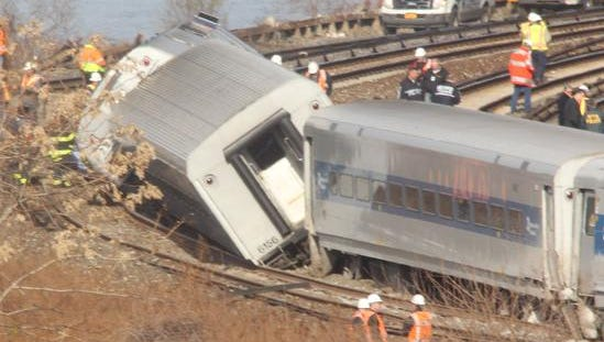 Emergency workers at a Metro-North train derailment in the Bronx Dec. 1, 2013.