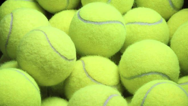 .Pile of loose tennis balls