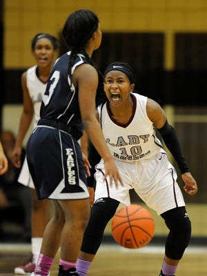 Romulus girls basketball player Khaliah McCord (10), right, fires herself up on defense as she guards Chandler Park Academy player DeShauna Walker (3) in the first quarter.