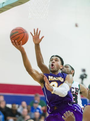 Marion High School senior James Blackmon Jr. (24) slips past the Arsenal Tech defense during the first half of varsity basketball action in a game of Indiana's Best Showcase at Marshall High School Dec. 23, 2013.