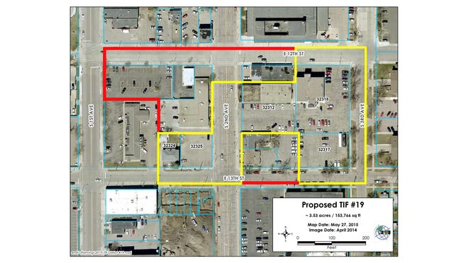 Five parcels of land have been removed from a Tax Increment Finance district being proposed by Legacy Development to facilitate an 82-unit housing complex in downtown Sioux Falls. The new borders, highlighted in yellow, will be presented Wednesday to the Sioux Falls Planning Commission. The same body in March signed off on the original, extended boundaries, shown in red.