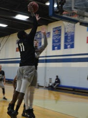 Kellogg Community College freshman Treyvonn Munson (11) attacks the basket during a recent practice.