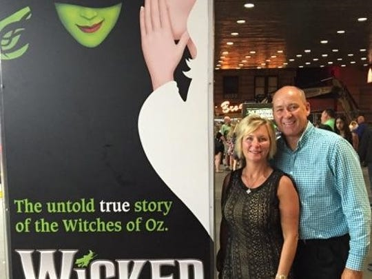 "Wicked in New York No one will argue that a trip to NYC is always a good thing but to celebrate an anniversary makes it even better.  Dirk and Cindy Brinker recently spent a few magical days in the Big Apple as they celebrated 23 years of wedded bliss. Posing in front of the Gershwin Theatre for a performance of ""Wicked"" are Cindy and Dirk."