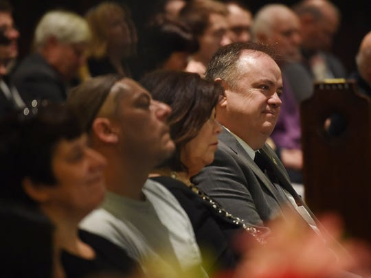 Matthew McNamara reacts to stories told during the funeral service of his husband Tracy Hermann at Christ Episcopal Church in the City of Poughkeepsie on Wednesday.