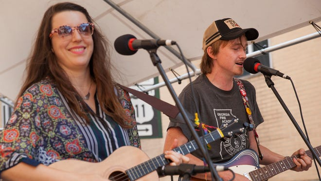 """Pete Stallings, right, and Shona Carr, of the band """"Lost Indian,"""" perform during the Staunton Jams street concert on Saturday, Aug. 30, 2014."""