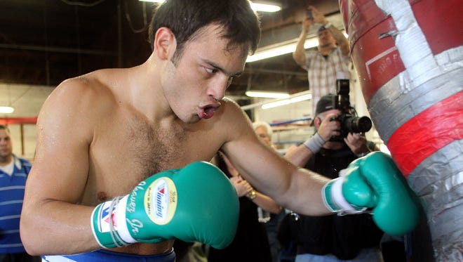 Former WBC middleweight champion Julio Cesar Chavez Jr. works out during media day in Los Angeles on Tuesday. He is preparing for Saturday's 12-round bout against Bryan Vera.