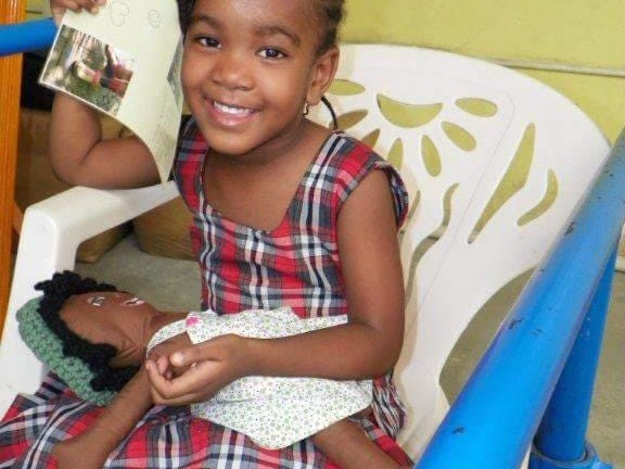 Eighth grader Erica Silvey sent culturally accurate dolls with limb loss to Haitian children victimized in a catastrophic 2010 earthquake.