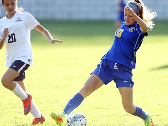 Butler's Avery Specchio controls the ball in front