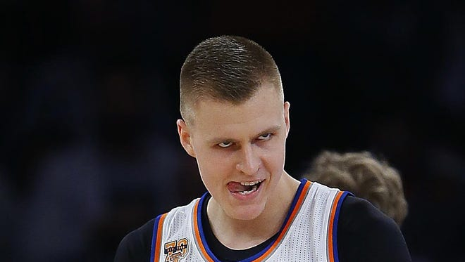 Nov 16, 2016; New York, NY, USA; New York Knicks forward Kristaps Porzingis (6) reacts after scoring a basket on a dunk against the Detroit Pistons during first half at Madison Square Garden.