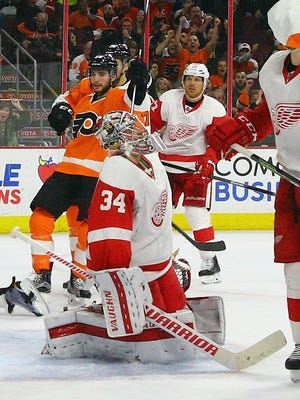Shayne Gostisbehere #53 of the Philadelphia Flyers celebrates his goal at 18:54 of the third period against Petr Mrazek #34 of the Detroit Red Wings at the Wells Fargo Center on March 15, 2016 in Philadelphia, Pennsylvania.
