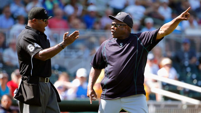Seattle Mariners manager Lloyd McClendon, right, continues arguing with umpire Alan Porter after the manager was ejected from the game after Mariners' batter Rickie Weeks had two baseballs thrown behind him by Cleveland Indians' Bruce Chen during the fourth inning of a spring training baseball game Tuesday, March 31, 2015, in Goodyear, Ariz.  McClendon wanted the pitcher ejected but the umpire gave both teams warnings.