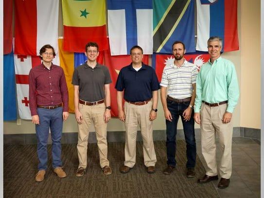 Oak Ridge National Laboratory's Derek Rose, from left,