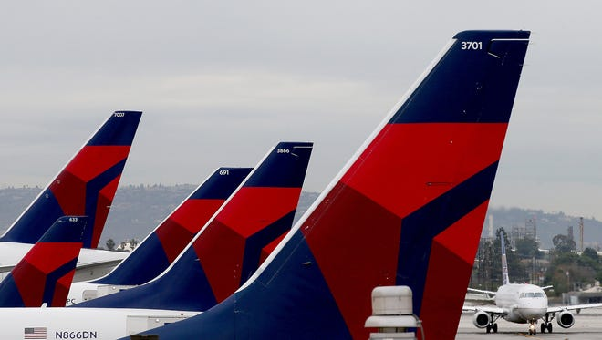 A sex act allegedly performed mid-flight by a 48-year-old Delta passenger with a 28-year-old man she'd never met has landed the two in hot water. (Luis Sinco/Los Angeles Times/TNS)