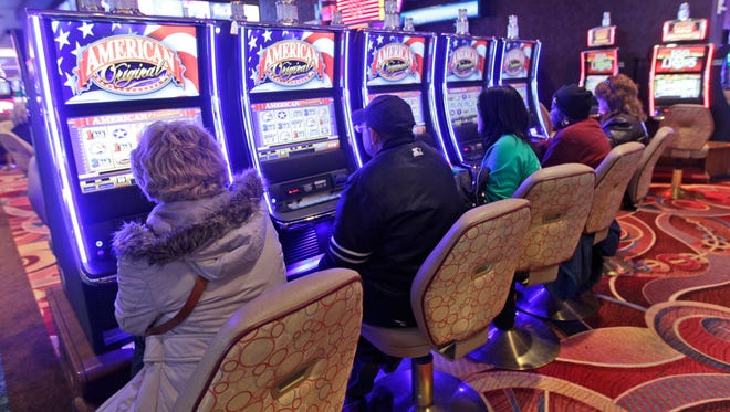 Gamblers play the slot machine machines at the Resorts World Casino,  Jan. 4, 2012, in the Queens borough of New York City.