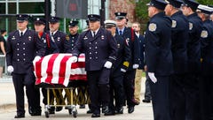 Mourners, including 700 uniformed officers, honor firefighter killed in blast