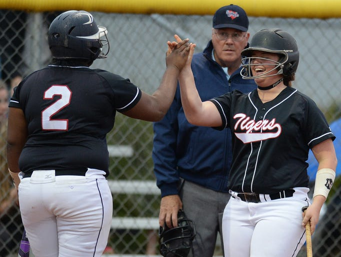 Blue Ridge's Sametra Duck (2) is congratulated by teammate Bryanna Waddell (3) after scoring against Pickens in the first inning Friday, March 28, 2014 at Blue Ridge High in Greer.