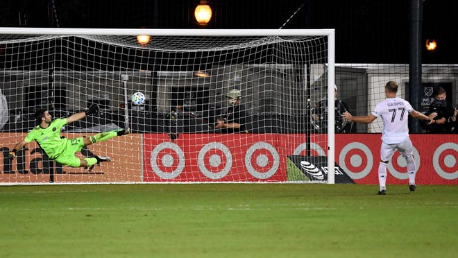 Minnesota United defender Chase Gasper scores on Crew goaltender Andrew Tarbell  during penalty kicks to win Tuesday night's game. The loss knocked the Crew out of the MLS is Back tournament.