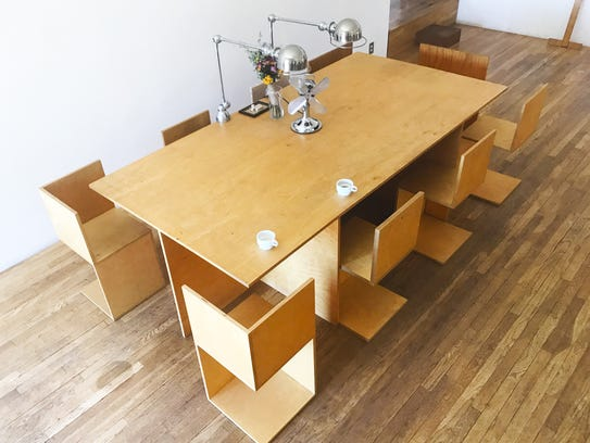 The table and chairs were designed and built by the