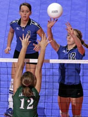 Olympian Kayla Banwarth (1), shown here in days as a star at Dubuque Wahlert.