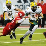 North Dakota State's Carson Wentz (11) carries the ball during the first half of a game against USD on Saturday, Oct. 25, 2014, at the DakotaDome in Vermillion, S.D. The Bison defeated the Coyotes 47 to 7.