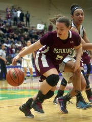 Ossining's Kelsey Quain grabs a rebound during the
