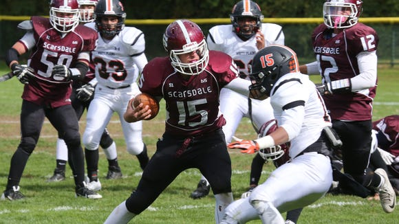 Scarsdale quarterback Michael Rolfe tries to get past