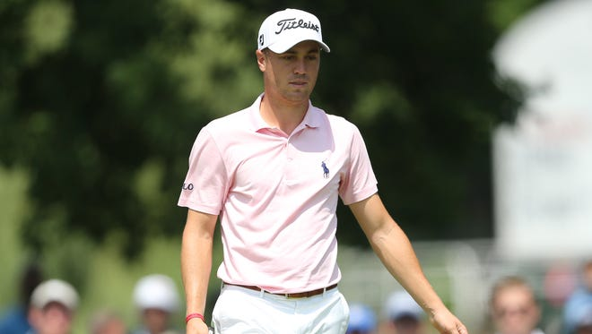 Justin Thomas reacts to his putt on the on the ninth green during the third round of The Memorial golf tournament at Muirfield Village Golf Club.