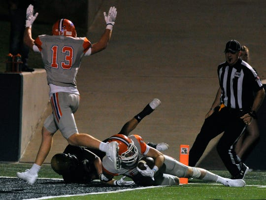 San Angelo Central's Philip Lupton raises his arms