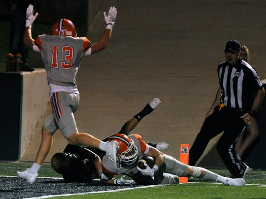 San Angelo Central's Philip Lupton raises his arms after wide receiver Henry Teeter is tackled into the end zone during the Bobcats' game against Abilene High School Friday Sept 1, 2017 during the 13th Annual Champions Classic.
