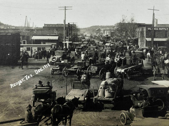 Cars fill the street of Ranger in this photograph from December 1918,