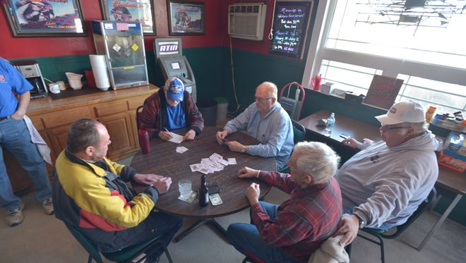 """A group of retirees play rummy at Scotty's Saloon in Grundy Center, Iowa. When asked if there were Democrats in their presence, one quipped """"the only Democrat we knew fell in the parking lot."""""""