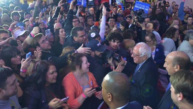 Supporters of Bernie Sanders mod their candidate after he gave a speech on caucus night in Des Moines, Iowa, Monday, Feb. 1, 2016.