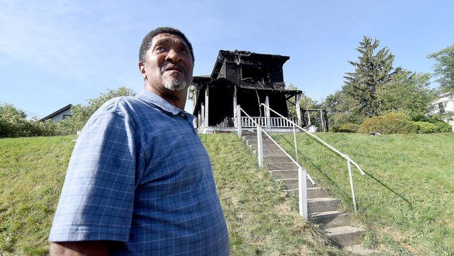 Eddie Howell is devastated by the fire damage that destroyed the apartment at 301 W. Fourth St. early Friday morning. The fire displaced Howell and seven other tenants.