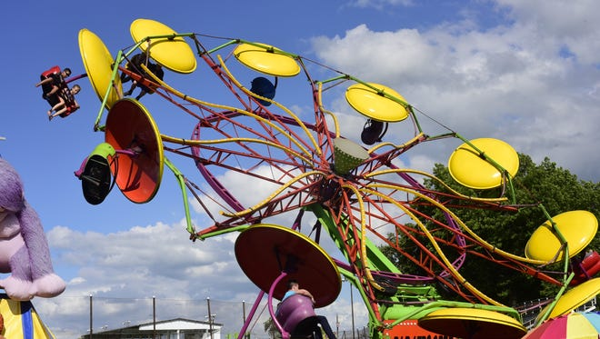 Mechanical rides dominated the midway at the Sandusky County Fair in 2016, providing entertainment for patrons of all ages.