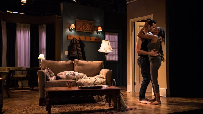 """Nick Narcisi and Marti Gobel embrace in Renaissance Theaterworks' """"Sex With Strangers."""""""