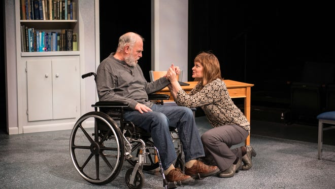"James Pickering and Tami Workentin share a scene in ""The Secret Mask,"" performed by Next Act Theatre."