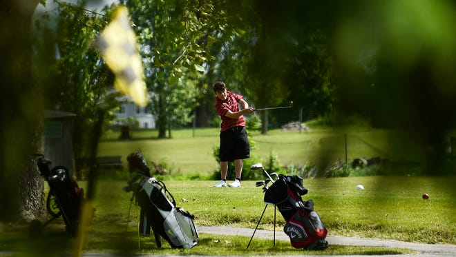 A golfer tees off at Green Acres Golf Course during the first Heart of Ohio Junior Golf Association tournament of the season. This summer marked the 30th anniversary of HOJGA..