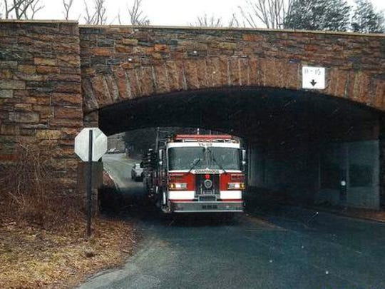 Officials from the Chappaqua Fire Department have questioned whether the Hunts Place site of the Chappaqua Station complex is accessible to firetrucks. The photo shows a firetruck passing through an underpass near the site. Fire officials have also raised concerns about the single entrance to the site, which has become flooded or blocked during previous storms.