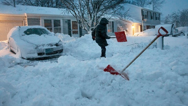 A Barnegat Township resident starts the painful job of shoveling out Saturday morning as the snow stills keeps coming down.
