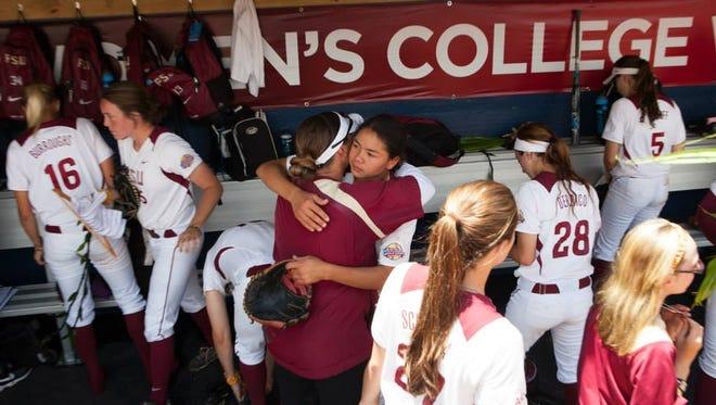 FSU coach Lonni Alameda and senior outfielder Courtney Senas embrace following the game.