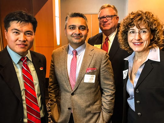 From left, Brian Gao DCBA president, Syed Murtaza from